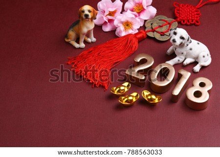 Miniature dogs with chinese new year decorations for year 2018
