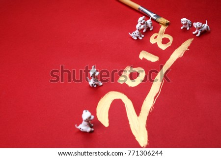Miniature dogs with year 2018 painted in gold. 2018 is the year of the dog according to chinese zodiac calendar.