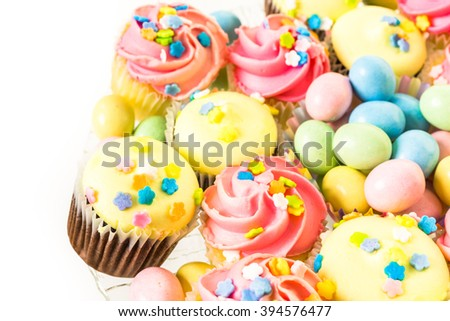 Miniature Easter cupcakes with pastel color iving.