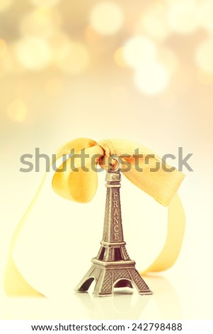 Miniature Eiffel-tower with defocused spot lights in background. - stock photo