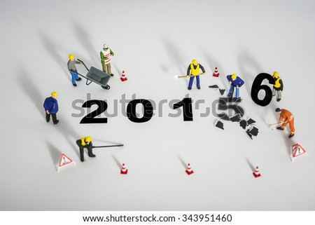 Miniature engineer or technician change represents the new year 2015- 2016 - stock photo