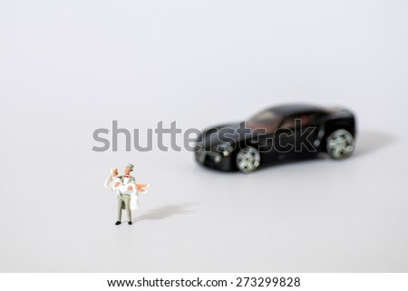 Miniature figure of bride and groom in wedding ceremony concept  - stock photo