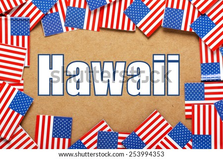 Miniature flags of the United States of America form a border on brown card around the name of the state of Hawaii