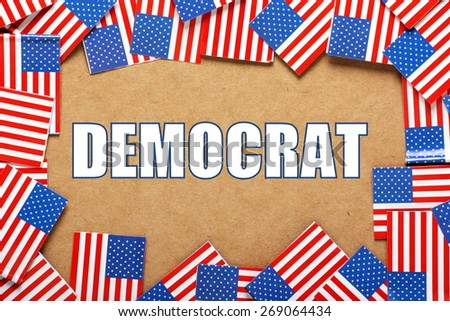 Miniature flags of the United States of America form a border on brown card around the name of the Democrat political party