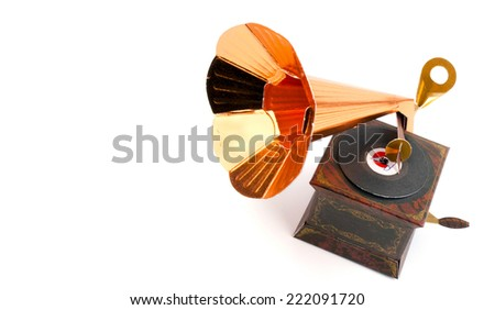 Miniature gramophone on white background. Souvenir of the paper - stock photo
