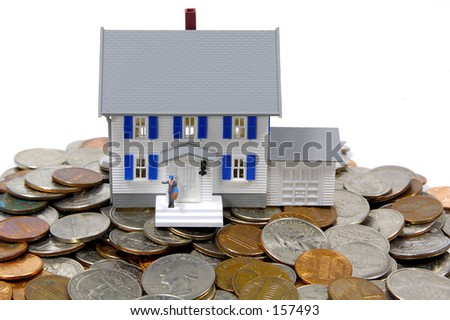 Miniature House and Change.  Home Savings / Mortgage Concept.  See Portfolio For Similar Concepts - stock photo