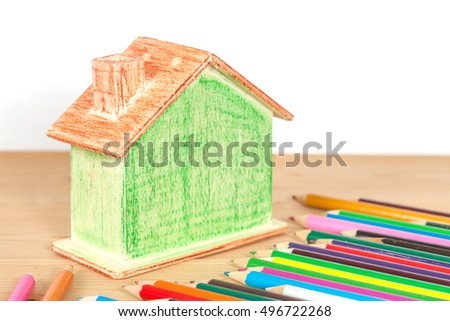 Miniature house with color pencil on wood