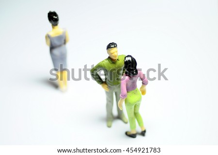 Miniature Man chatting with woman, and single woman turning back