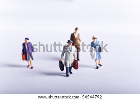 miniature man on travel