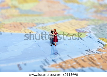miniature man on world map - stock photo