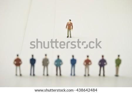 Miniature men - stock photo