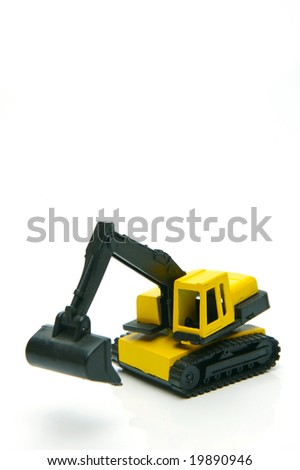 Miniature model earth moving equipment isolated against a white background