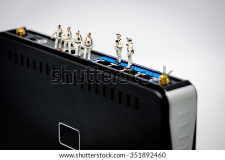Miniature network engineers at work. Macro Photo - stock photo