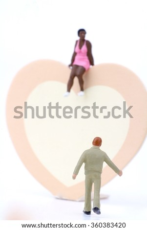 miniature of a couple with a big heart - lovers concept - stock photo