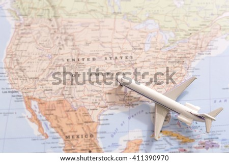 Miniature of a passenger airplane flying on the map of United States of America from south east. Conceptual image for travel and tourism
