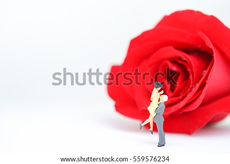 Miniature of a women and a man in love with red rose in white background, copyspace, couple in love and pre-wedding background Valentine's Day concept