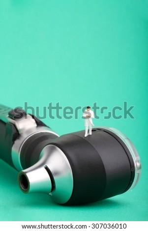 miniature of an otolaryngologist specialist and otoscope - stock photo