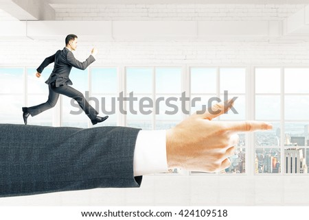 Miniature of businessman running on arm pointing forward in empty brick interior with city view - stock photo
