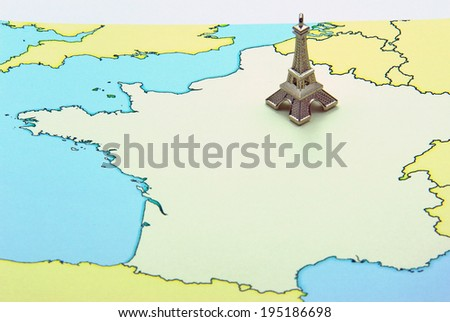Miniature of Eiffel Tower on France map. France traveling concept - stock photo