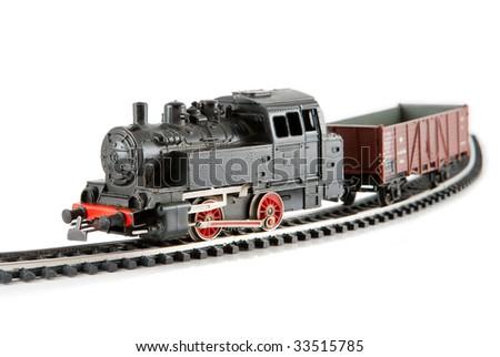 Miniature old locomotive on a track - stock photo