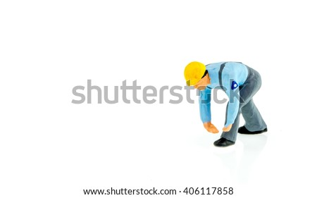 Miniature people engineer worker construction concept on white background with a space for text - stock photo