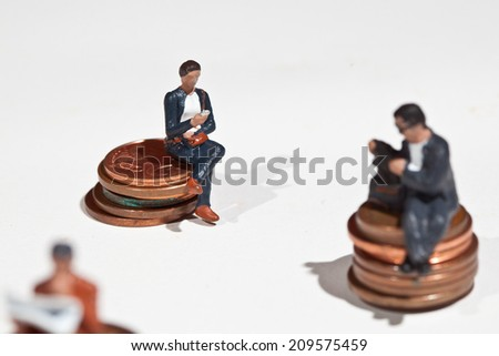 Miniature people in action in various situations