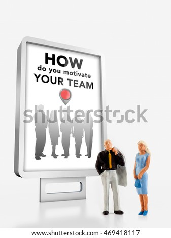 Miniature people in front a billboard about motivation work