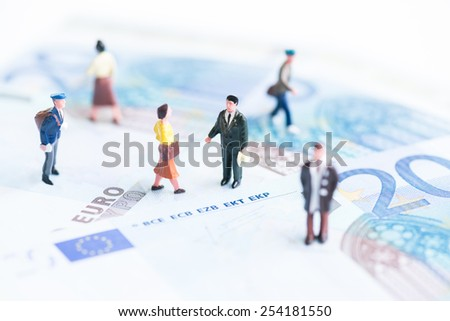 Miniature people on Euro banknotes
