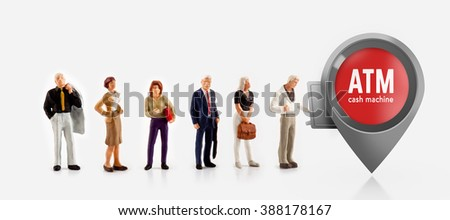 miniature people  - people stand in front a ATM machine for cash money