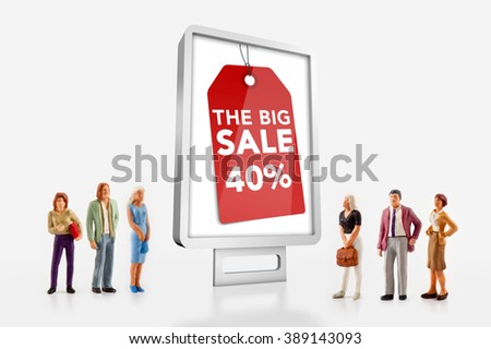 miniature people  - people standing in front of billboard with big sale ad