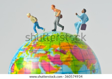 miniature people running around the globe