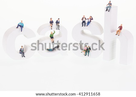 Miniature people sitting on cash letters