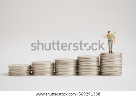 Miniature people: small figures worker  stand on top of coins. Money, Financial, Business Growth concept.