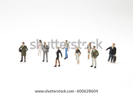 miniature people (toy) on white background.