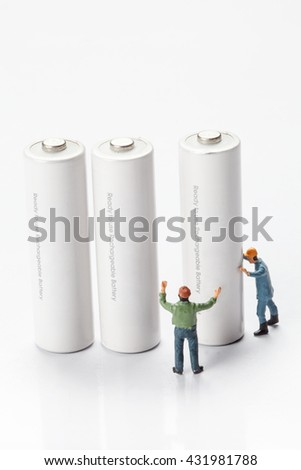 miniature people  - workers moving and recycle batteries,  isolated on white  - stock photo