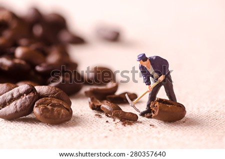 Miniature people working on coffee blend process - stock photo