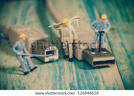Miniature people working  ,selective focus