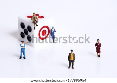 Miniature peoples with dice - stock photo