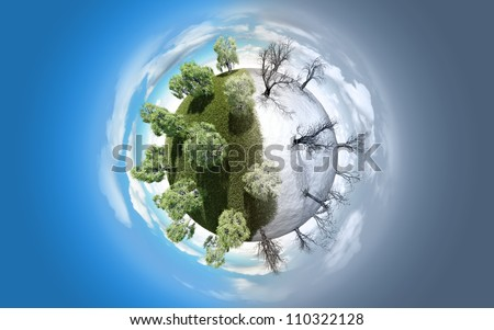 Miniature planet with green summer trees and leafless winter vegetation, atmosphere with clouds and copy-space - stock photo