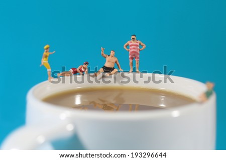 Miniature Plastic People Swimming in Coffee