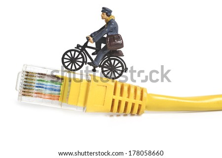 Miniature postman sending mail - stock photo