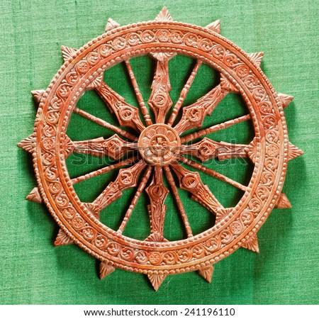 Miniature replica of Konark Sun Temple wheel Orissa India South East Asia - stock photo