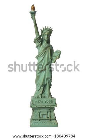 miniature replicate of the statue of liberty on white  - stock photo
