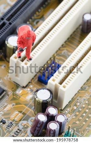 miniature scientist checking toxic on the computer motherboard - stock photo