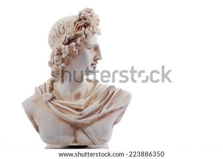 Miniature sculpture of ancient Greece of Apollon. The god of light and the sun, truth and prophecy, medicine and healing, archery, music, poetry, arts and more. Sculpture isolated on white background - stock photo