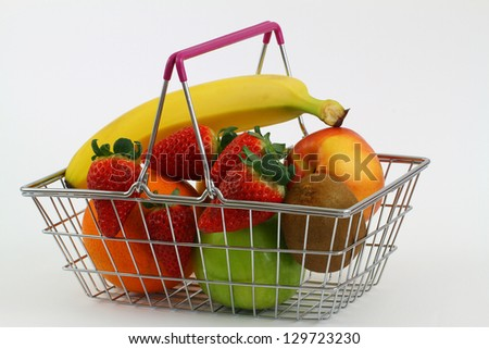 Miniature shopping basket filled with fresh fruit