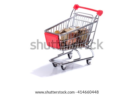 Miniature shopping cart with Euro coins, money, isolated on white background - stock photo