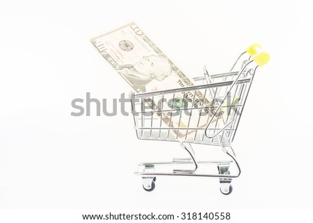 Miniature shopping cart with ten US dollar banknote close up - stock photo
