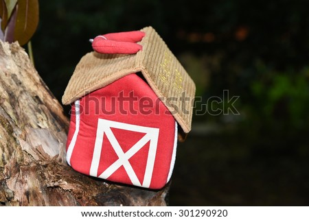 miniature small red color house on tree. tree house - stock photo