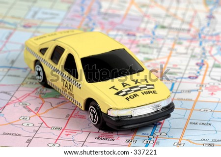 Miniature Taxi on a map - stock photo
